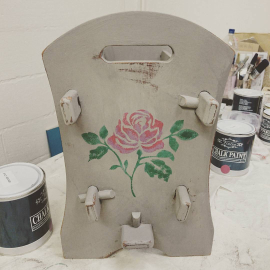 newspaper-rack-with-rose-stencil